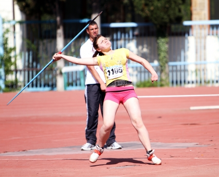 YALTA, UKRAINE - APRIL 26  Silkina Elizaveta compete in the javelin throw competition for girls age 16-17 on Ukrainian Junior Track and Field Championships on April 26, 2012 in Yalta, Ukraine