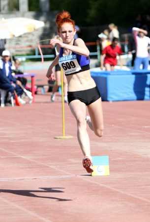 On the triple jump competition for girls age 16-17 on Ukrainian Junior Track and Field Championships on April 25, 2012 in Yalta, Ukraine  Stock Photo - 13669324