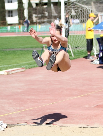 On the long jump competition for girls age 16-17 on Ukrainian Junior Track and Field Championships on April 25, 2012 in Yalta, Ukraine  Stock Photo - 13669325