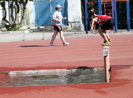 steeplechase: Girl compete in the 2000 Meter Steeplechase on Ukrainian Junior Track and Field Championships on april 27, 2012 - Yalta, Ukraine
