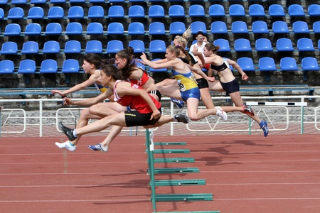 Yalta, Ukraine - May 24  girls age 17  at the hurdles race on the international athletic meet UKRAINE - TURKEY - BELARUS on May 24, 2012 in Yalta, Ukraine