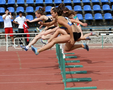 Yalta, Ukraine - May 24  girls age 17  at the hurdles race on the international athletic meet UKRAINE - TURKEY - BELARUS on May 24, 2012 in Yalta, Ukraine