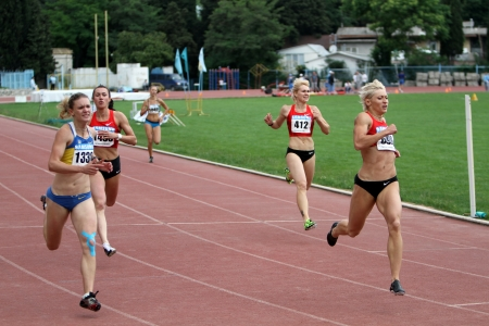 Yalta, Ukraine, May 28: (L-R) Piatochenko Viktoria, Bryzgina Elyzaveta, Mariya Ryemyen and Pogrebniak Natalia on the finish of 200 meters dash on the Ukrainian Cup in Athletics, on May 28, 2012 in Yalta, Ukraine Stock Photo - 13847251