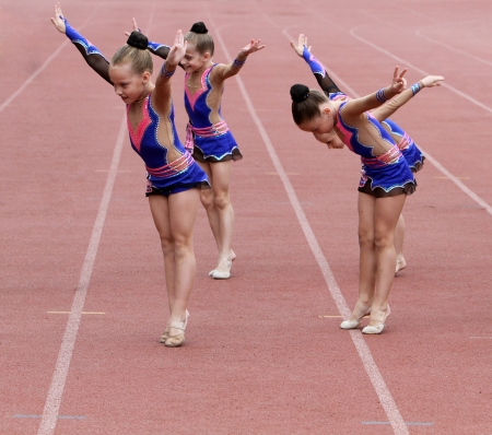 Girls perform on the opening ceremony of the international athletic meet between Ukraine, Turkey, Belarus on May 24, 2012 in Yalta, Ukraine
