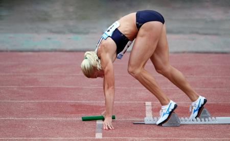 Pigida Natalia on the start at the relay race on Ukrainian Cup in Athletics, on May 29, 2012 in Yalta, Ukraine   Stock Photo - 14139497