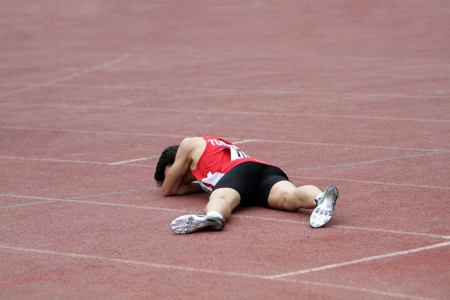 Altintash Batuhan from Turkey after relay race on the international athletic meet between UKRAINE, TURKEY and BELARUS on May 25, 2012 in Yalta, Ukraine