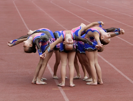 Unidentified girls perform on the opening ceremony of the international athletic meet between Ukraine, Turkey, Belarus on May 24, 2012 in Yalta, Ukraine