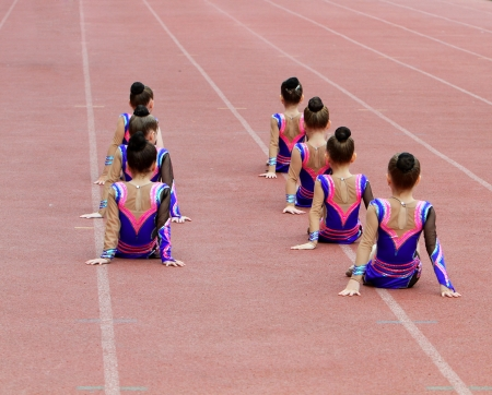 Girls perform on the opening ceremony photo