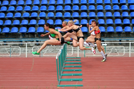 YALTA, UKRAINE - MAY 28   L-R  Melnichenko Anna, Fedorova Alina, Mohnuk Nastia, Sinisa Ina, Kuzminok Oksana compete in heptathlon on Ukrainian Cup in Athletics on May 28, 2012 in Yalta, Ukraine