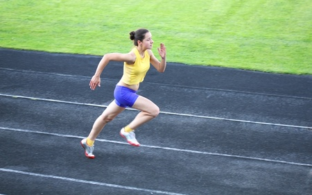 Girl running on the track Stock Photo - 14159598