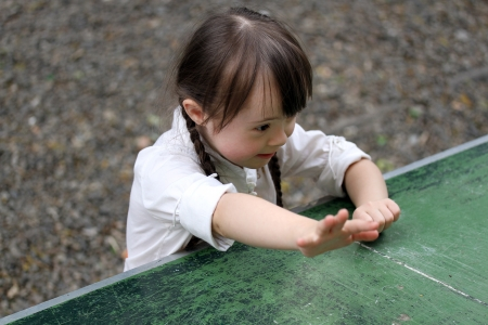 Portrait of beautiful young girl playing photo