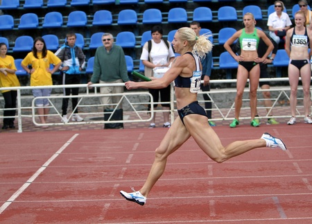 Athletes on the finish of the relay race on Ukrainian Cup in Athletics on May 28, 2012 in Yalta, Ukraine