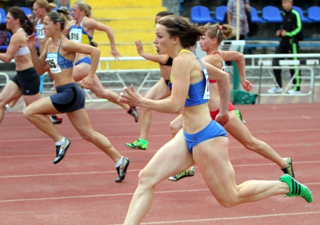 Athletes on the finish of the 100 meters race on Ukrainian Cup in Athletics on May 28, 2012 in Yalta, Ukraine