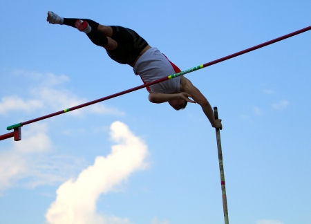 YALTA, UKRAINE - JUNE 01: Haletski Rostislav compete in the pole vault competition on Ukrainian Junior Track and Field Championships on June 01, 2012 in Yalta, Ukraine