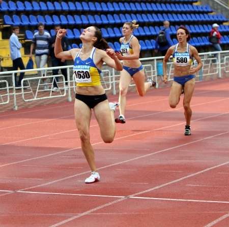 YALTA, UKRAINE - JUNE 01:(L-R) Kolesnichenko Olena, Slusarenko Katerina,  Lebed Anastasia compete in the 400 meters race on Ukrainian Track & Field Championships on June 01, 2012 in Yalta, Ukraine Stock Photo - 14360160