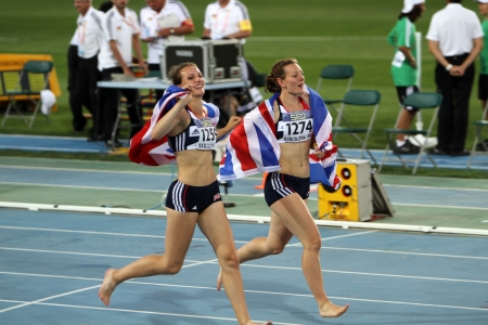 Katy Marchant and Emma Bucket after the finish of the Heptathlon event on the IAAF World Junior Championships on July 13, 2012 in Barcelona, Spain