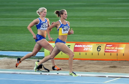 BARCELONA, SPAIN - JULY 14   L-R  Henna Palosaari and Nataliia Bashly compete in the 800 meters Heptathlon on the 2012 IAAF World Junior Athletics Championships on July 14, 2012 in Barcelona, Spain