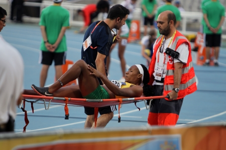 BARCELONA, SPAIN - JULY 12: Red Cross providing first aid to injured athlete on the 2012 IAAF World Junior Athletics Championships on July 12, 2012 in Barcelona, Spain.