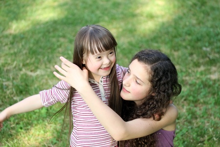 Portrait of beautiful young girls in the park Stock Photo - 14709436
