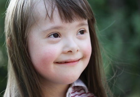Portrait of beautiful young girl in the park. photo