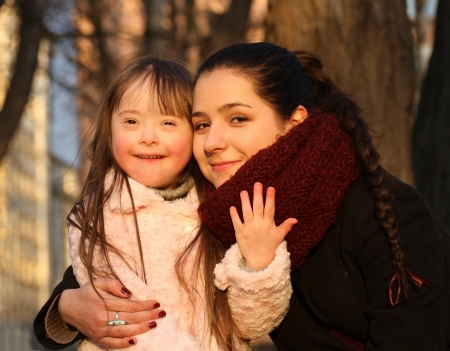 down syndrome: Family moments - Mother and child have a fun