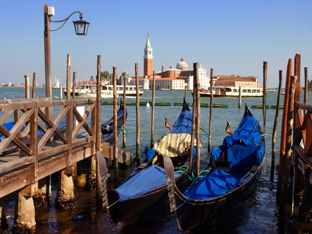 venecian: Gondolas anchored on Grand Canal in Venice