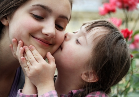 down syndrome: Happy family moments - Mother and child have a fun. Stock Photo