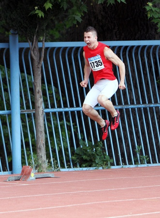 Maksimchuk Ivan is configured to participate in the 200 meters race on Ukrainian Track   Field Championships on June 01, 2012 in Yalta, Ukraine   Stock Photo - 16102649