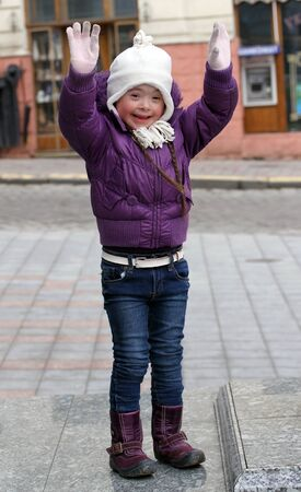 Portrait of beautiful happy girl holding hands up  photo