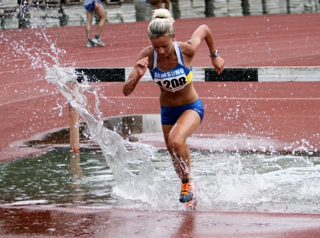 Girl compete in the 3 000 Meter Steeplechase on Ukrainian Track   Field Championships on June 01, 2012 in Yalta, Ukraine
