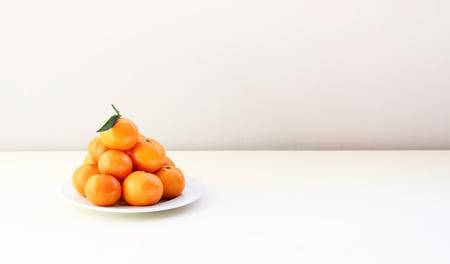 Mandarins on the white table Stok Fotoğraf