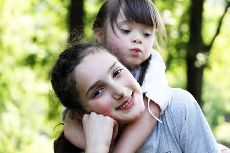 Portrait of beautiful young girls in the park . photo