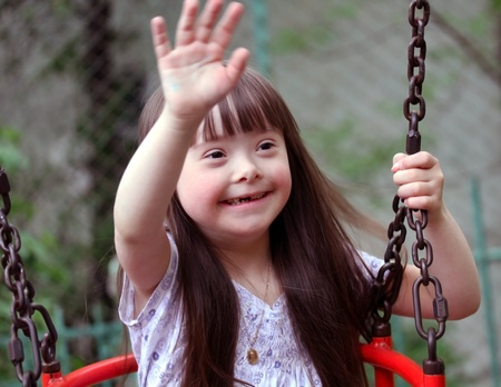 children at play: Portrait of beautiful young girl on the playground Stock Photo