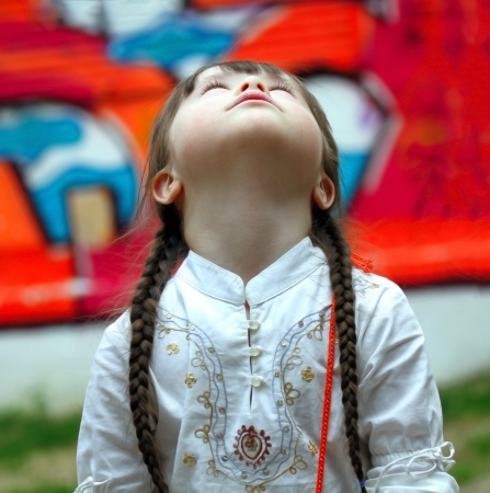 calm down: Portrait of beautiful young girl looking up on playground Stock Photo