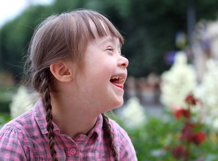 face down: Portrait of young happy girl smiling. Stock Photo