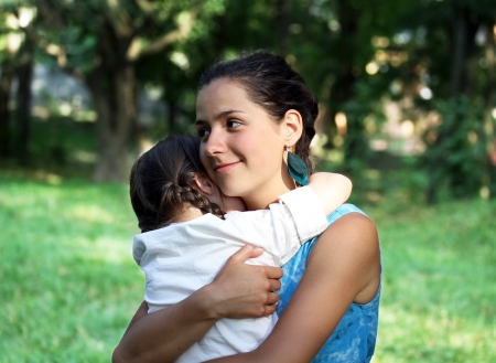 carrying girl: Happy family moments - Mother and child have a fun