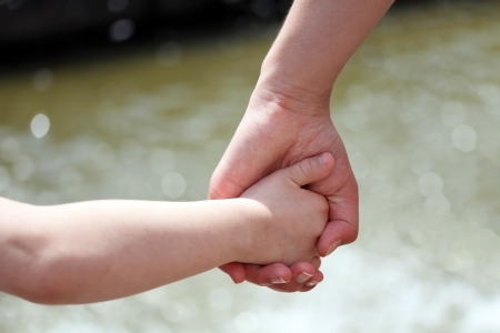 Hands of mother and child Stock Photo - 18087209