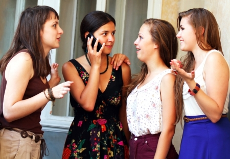 social life: Beautiful student girls during phone call Stock Photo