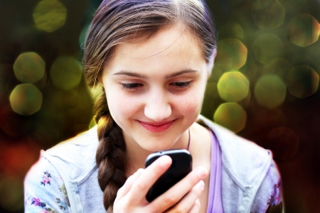 sms text: Girl with a mobile phone reads the message Stock Photo