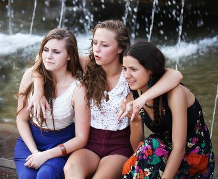 school friends: Students girls having fun outside.