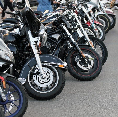 parked: Motobikes in a row. Stock Photo