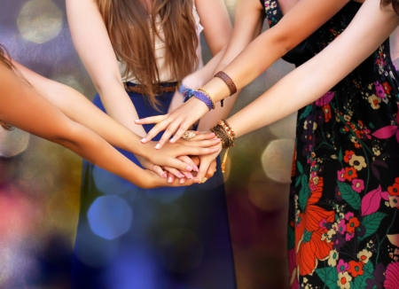 Happy Teenage Group with Hands on Stack.