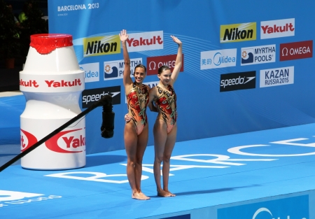 olivia: FEDERICI Olivia and RANDALL Jenna from Great Britain in Duet Technical Routine Synchronised Swimming on 15th FINA World Championships on July 21, 2013 in Barcelona,Spain Editorial