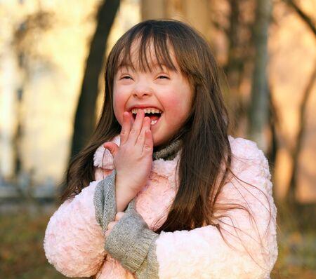 Portrait of funny little girl outside photo