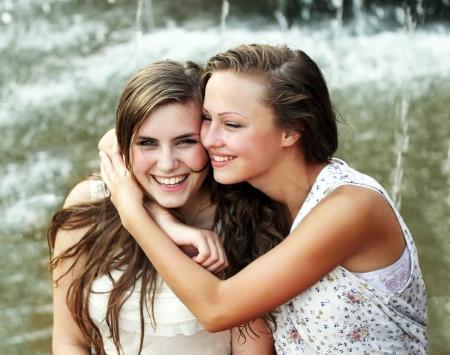 pretty teen girl: Students girls having fun outside