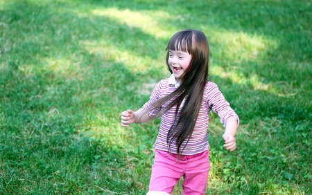 Portrait of beautiful young girl in the park Stock Photo