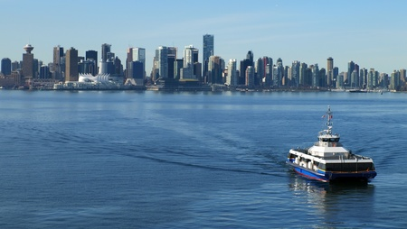 ferries: Vancouver Canada cityscape with sea bus.