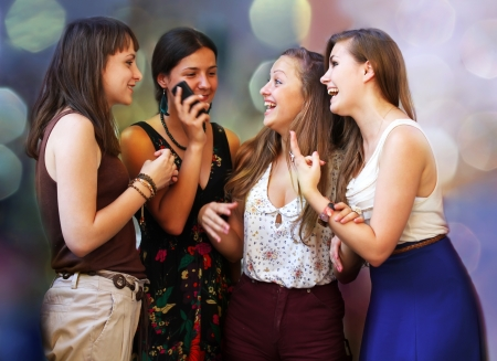 Beautiful student girls happy during phone call Stock Photo