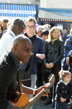 african sax: Group of musicians as seen on Montmartre in Paris on October 13, 2013 in Paris, France