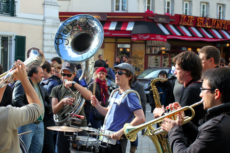dozens: PARS, FRANCE - OCT  13  Group of young musicians as seen on Montmartre in Paris on October 13, 2013 in Paris, France  Dozens buskers perform on the streets and in metro of Paris  Editorial